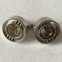 Vintage silver tone cufflinks with round faceted smokey quartz color stone in the center, signed SWANK