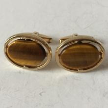 Gold plated cufflinks with oval shape flat genuine tiger eye slabs, signed FOSTER