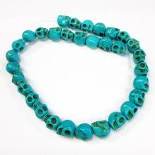 Turquoise colored skull shaped beaded necklace