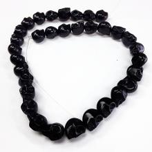 Black colored skull shaped beaded necklace