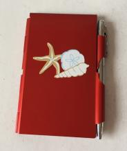Small red metallic  FLIPNOTES notebook with attached pen and sea motive design on front