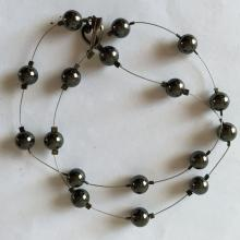Black round hematite beads on wire necklace with toggle clasp