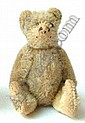 A small Schuco plush honey bear with boot button eyes and articulated limbs (worn).