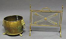 A brass coal bucket, with lions mask handles, on c