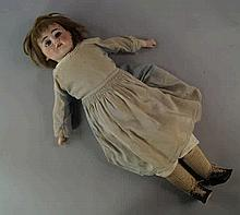 A German porcelain headed doll, late 19th/early 20