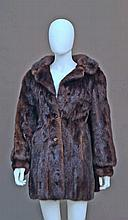 A dark mink jacket, with button fastening and side