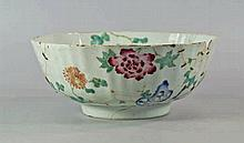 A Chinese porcelain bowl, painted in the famille r