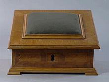 A Continental wooden banded sewing box, 20th centu
