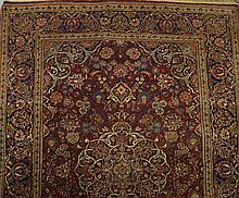 A pair of Kashan rugs with poe medallion in claret