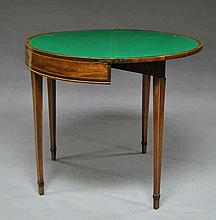A George III mahogany fold over card table, raised