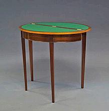 A George III style mahogany fold over card table,
