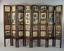 A Chinese eight fold panel screen, late 19th/early