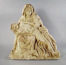 A limestone Pieta, probably 19th century, in the N