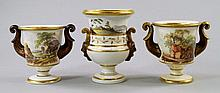 Two English porcelain painted and gilded twin