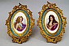 A pair of oval painted panels, possibly Sevres,