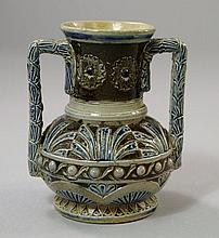 A Martinware twin handled stoneware vase, of
