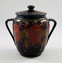'Pomegranate', a Moorcroft biscuit barrel by