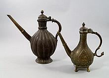 An Islamic bronze ewer, 19th century, central