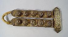 A parcel gilt white metal caparison ornament, the
