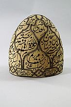 A Sufi hat, of domed form, rigid wool with Islaic