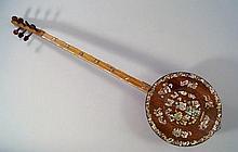 An Uygur Turkish stringed instrument, the circular