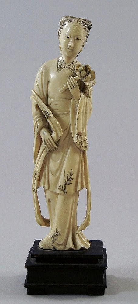 A Chinese ivory figure of a lady, late 19th
