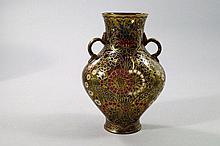 A Lobmeyr twin handled amber glass vase, Vienna,