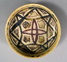A Kashan pottery bowl, Iran 11th century, of