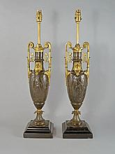 A pair of French gilt bronze and bronze side urns,