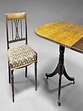 A mahogany dining table and six chairs, 19th centu