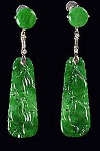 A pair of carved Chinese jade and diamond set ear pendants, retailed by Asprey & Co. Ltd, the jade p