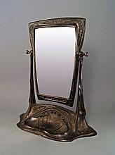 Attributed to J.P Kayser Sohn: A large Art Nouveau pewter dressing table mirror, early 20th century,