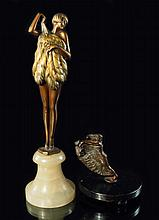 An Austrian cold painted bronze of a nude fan dancer, the young girl, with bobbed hair, holding an o