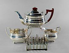 A modern silver three piece tea service, Sheffield c.1956, Mappin & Webb Ltd, comprising teapot, mil