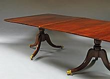 A George III style mahogany triple pedestal extending dining table, 20th century, raised on turned p