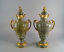 A pair of French green variegated marble and ormolu mounted urns and covers, late 19th/early 20th ce