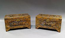 A pair of Chinese carved camphorwood trunks, 20th century, carved overall with scenes of figures in