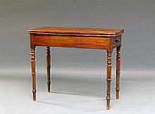 A George III mahogany tea table, with rectangular folding top, on turned cylindrical legs, 74 cm hig