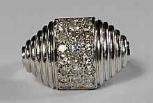 A white metal and diamond set cocktail ring, of sh
