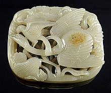 A Chinese carved white and russet jade egret and l