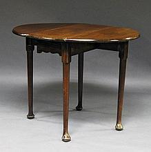A George II oval drop leaf table, on pad feet, 71