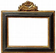 A Spanish Carved, Ebonised and Parcel Gilded Frame