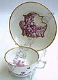 [ Subject to VAT ] A Meissen cabinet cup and saucer, late 18th Century, the exterior of both pieces moulded in relief and painted in puce with flowering branches, the interior of the cup with foliate sprigging, the saucer with a reserve of lowers,