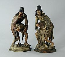 A pair of North Italian carved wood figures of