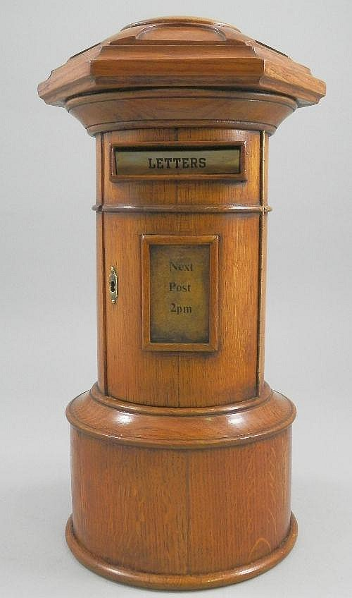 A carved oak post box, Late 20th Century, the
