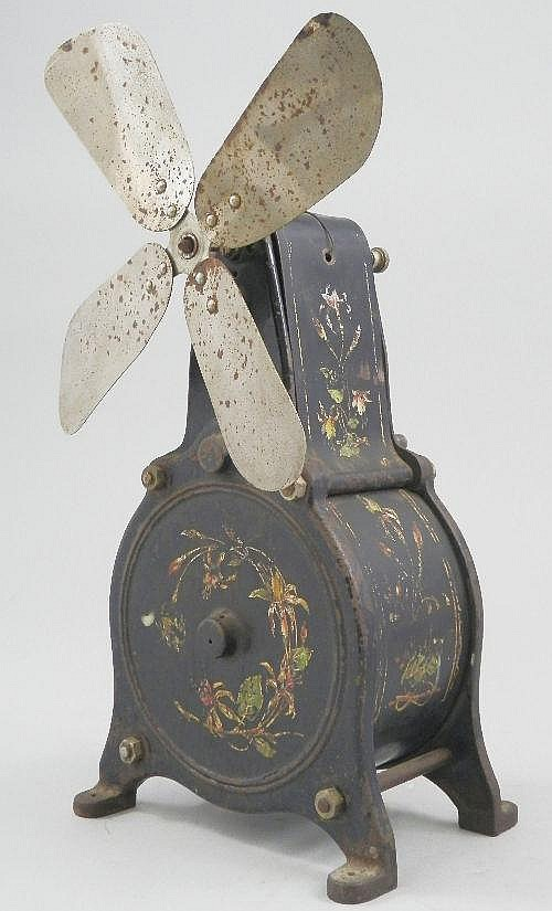 A iron table fan decorated with foliage, late