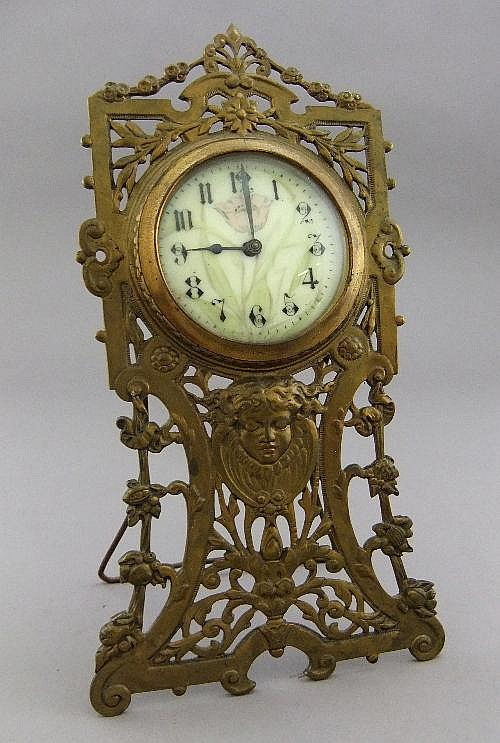 A Victorian gilt metal strut mantel clock, of