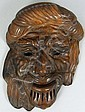 A terracotta wall mask, modelled as a gentleman's