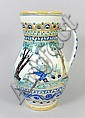 A 19th century European faience pottery jug, the