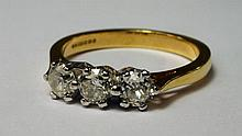 An 18ct gold, three stone diamond ring, approx 0.5